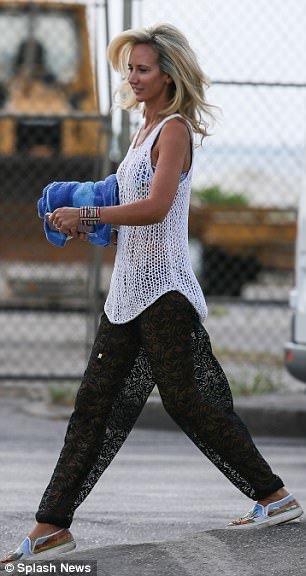 Killer accessories: She completed her look with several bangles and chic embellished slip-ons
