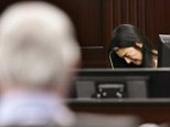 Rayne Perrywinkle broke down in tears on the witness stand on Monday while testifying against Donald Smith (left), who stands accused of kidnapping, raping and murdering her eight-year-old daughter