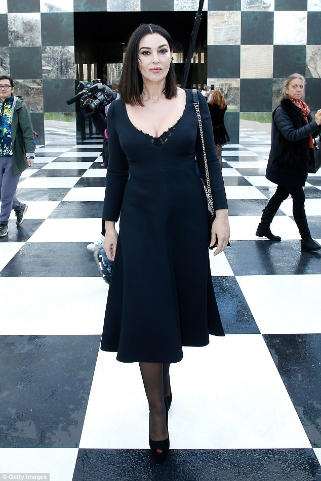 Age-defying: Youthful Monica flaunted her eye-popping cleavage in a plunging curvaceous gown as she makes an entrance at Dior's fashion show at Paris Haute Couture Fashion Week