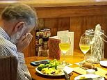A woman dining at a restaurant on Valentine's Day shared a heartbreaking image of a widower eating alone (pictured)
