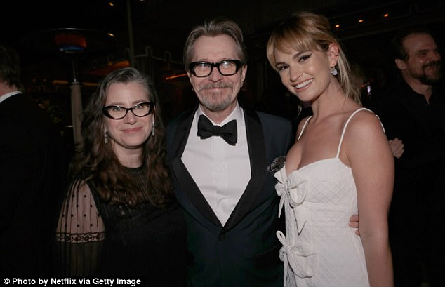 Industry event: The British actress showed off her effortless style in a plunging bow-detail dress as she posed alongside herDarkest Hour co-star, Gary Oldman