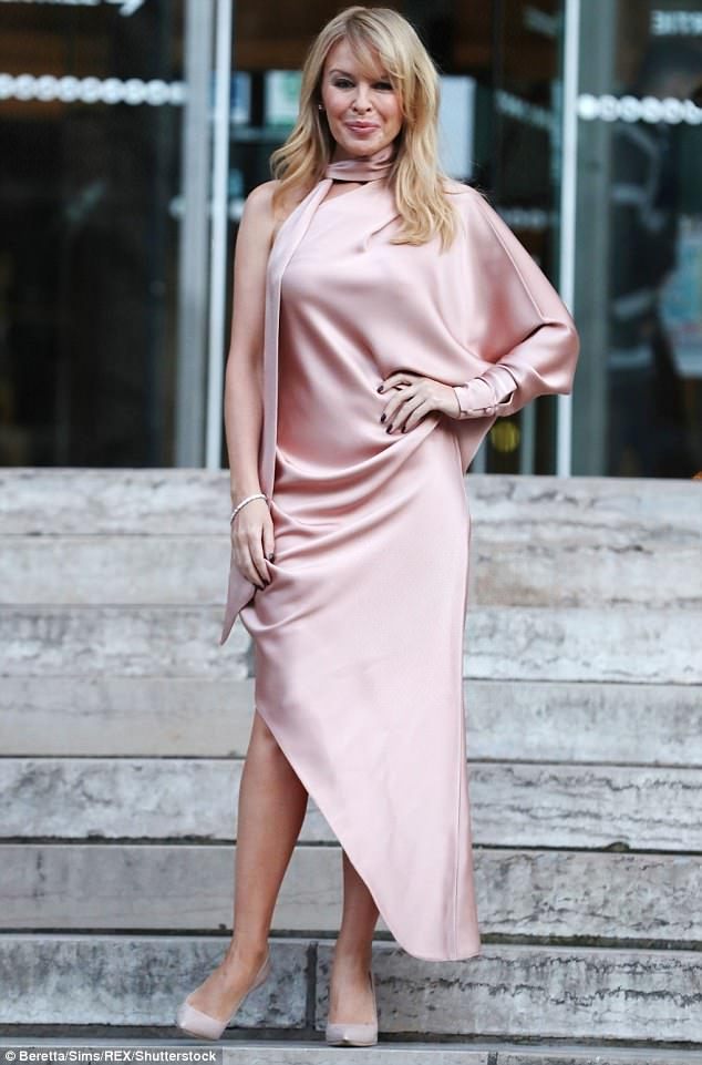 Glam:Never without a hint of glamour however, Kylie styled her blonde hair into loose, tousled waves, and added a dark smoky eye and matching pink lip in sultry finishing touches