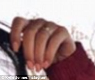 In the image Kylie has a ring on her wedding which appears to have diamonds on it