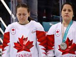 Dejected: Jocelyne Larocque (middle) immediately took off her silver medal after she was awarded it. Canada lost the gold to the USA in a nail-biting shootout on Thursday