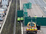 Grim discovery: Police closed the M20 motorway in Kent after the body of a 32-year-old woman was found on Tuesday evening