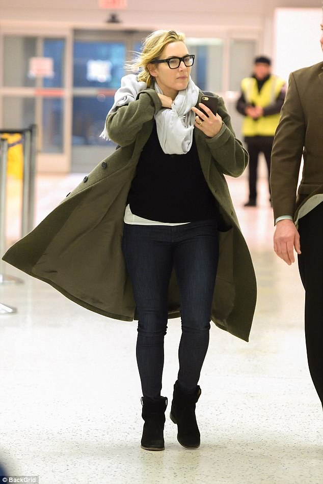 Walk it out: The 42-year-old actress was bundled up for the chilly weather in a large winter coat and heavy scarf as she walked through the terminal