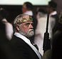 A man wears a crown and holds an unloaded weapon at the World Peace and Unification Sanctuary, Wednesday, Feb. 28, 2018, in Newfoundland, Pa. Worshippers clutching AR-15 rifles participated in a commitment ceremony at the Pennsylvania-based church. The event Wednesday morning led a nearby school to cancel classes for the day. The church's leader, the Rev. Sean Moon, said in a prayer that God gave people the right to bear arms. (AP Photo/Jacqueline Larma)