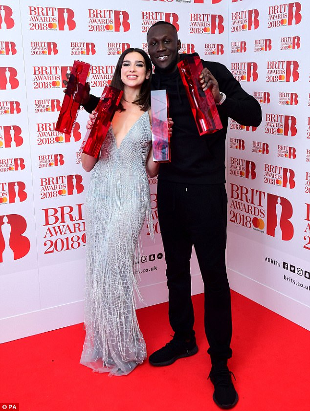 Superstars of the night: British artists Dua Lipa and Stormzy beamed in delight as they won two awards each at the BRIT Awards 2018, held at London's 02 Arena on Wednesday evening