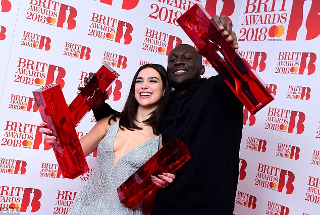 Proud: The duo took to the Winners' Room as they held up their crimson red oblong statues, designed by Sir Anish Kapoor