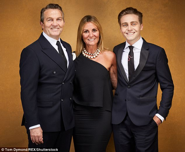 Quite the departure: At the start of the evening, Bradley had looked dapper in a professional shot with his wife Donna and son Barney