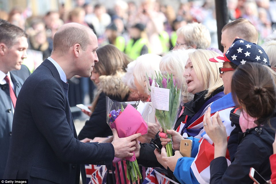 A particularly patriotic group of well-wishers could be seen presenting the Duke of Cambridge with several floral tributes
