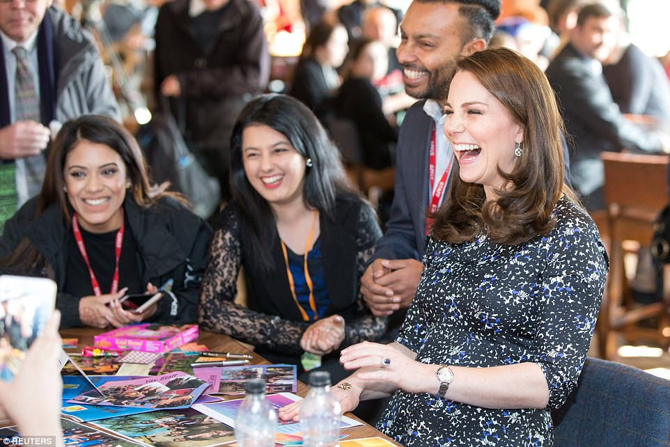 The Duchess appeared to be delighted with her henna tattoo and could be seen posing for photos once it was complete