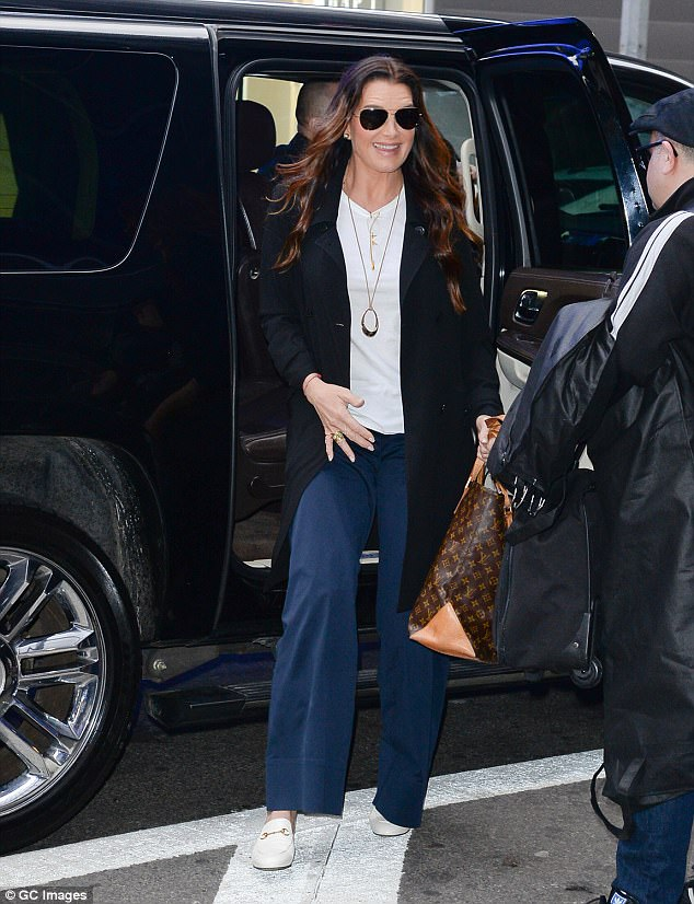 Different look: The beautiful brunette arrived in a white T-shirt and wide-legged jeans