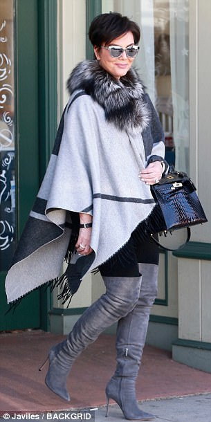 On the prowl: Kris, 62, looked just as stylish as her pregnant daughter as she rocked grey fur-lined cape for the occasion
