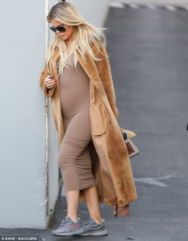 Blonde ambition: The expecting mom's long blonde tresses still hung down elegantly