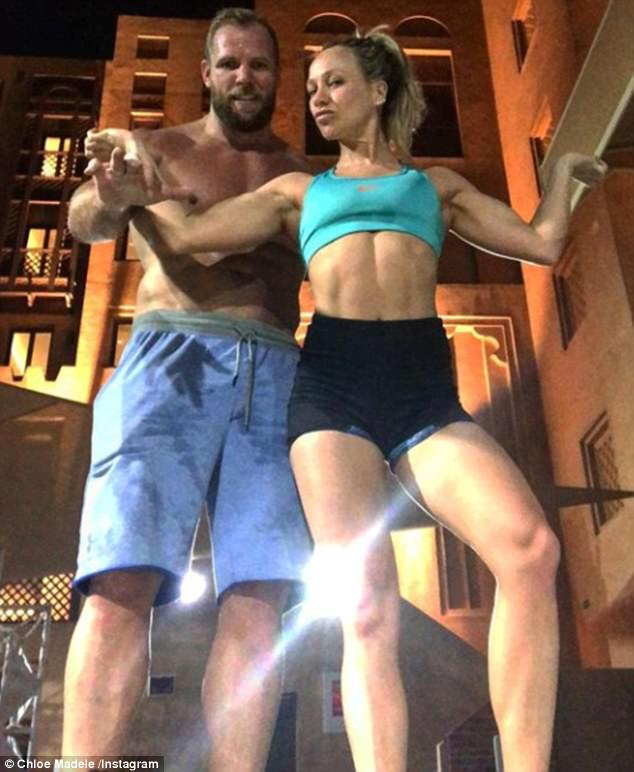 'Flexing': Chloe Madeley, 30, was joined by her beau James Haskell, 32, as they continued their quest for perfection during a late night workout session