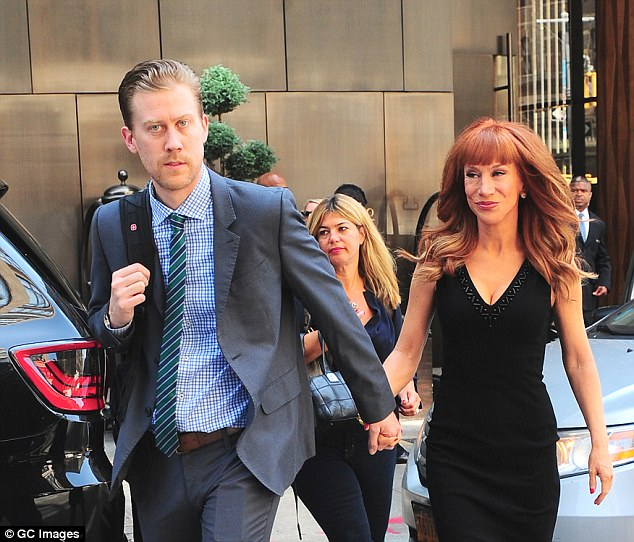 Aggrieved: Griffin and Mezger's disagreement started over noise complaints being made by the comedienne and her boyfriend Randy Bick (pictured together in New York in 2014)