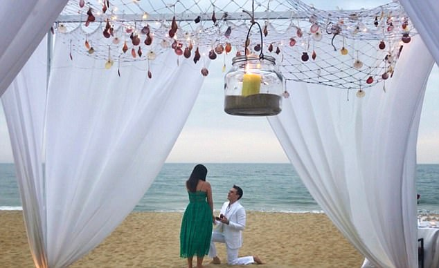 Gorgeous setting: The images see Louis down on one knee on a beach at the Four Seasons Resort The Nam Hai in Hoi An, Vietnam, popping the question in a dapper white suit