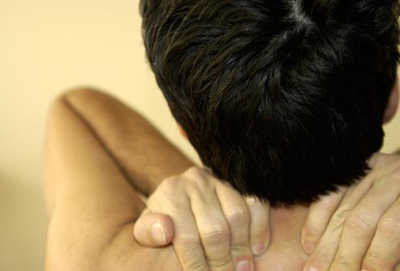 woman in pain rubbing her back