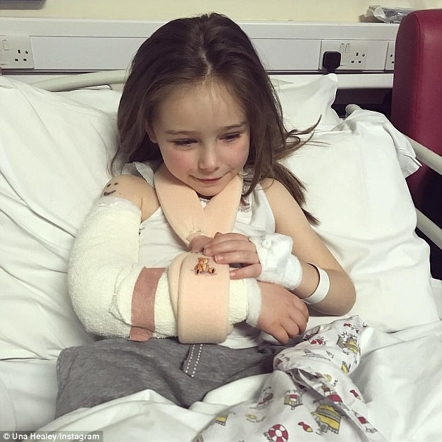 'Brave little trooper': Una Healy's daughter Aoife Belle Foden, five, has been hospitalised after falling over and chipping a bone in her elbow in a 'freak accident'