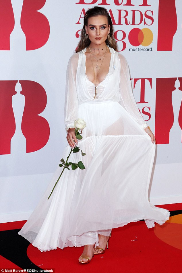 Give us a twirl! The beauty carried a white rose in homage to the #MeToo movement
