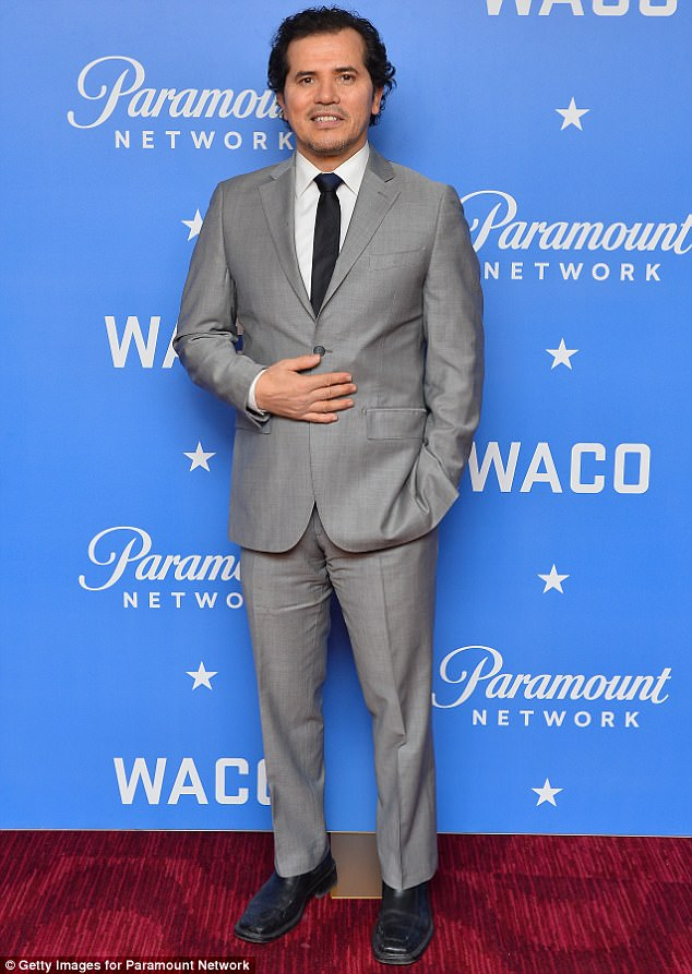 Grey scale: John Leguizamo looked sharp with a slate grey suit and curly locks