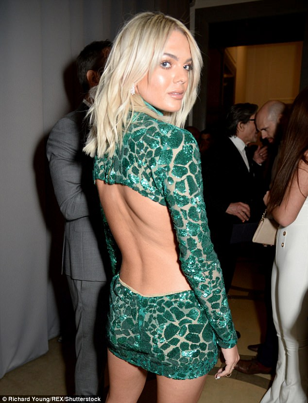 Saucy: Cutting an raunchy look with a new glittering green mini-dress, 20 year-old Louisa teased her washboard abs with the saucy stomach cutouts