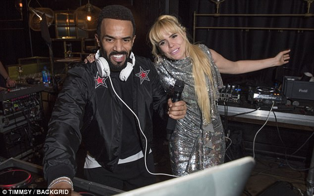 Hey Mr DJ: The Crybaby songstress made sure all eyes were on her as she styled her long golden tresses in a high ponytail with metallic accents, with soft tendrils framing her face