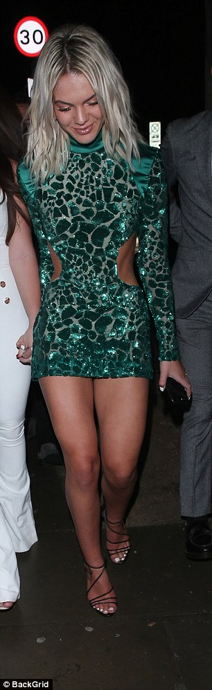 In she goes: Louisa smiled as she headed from the awards to the after-party