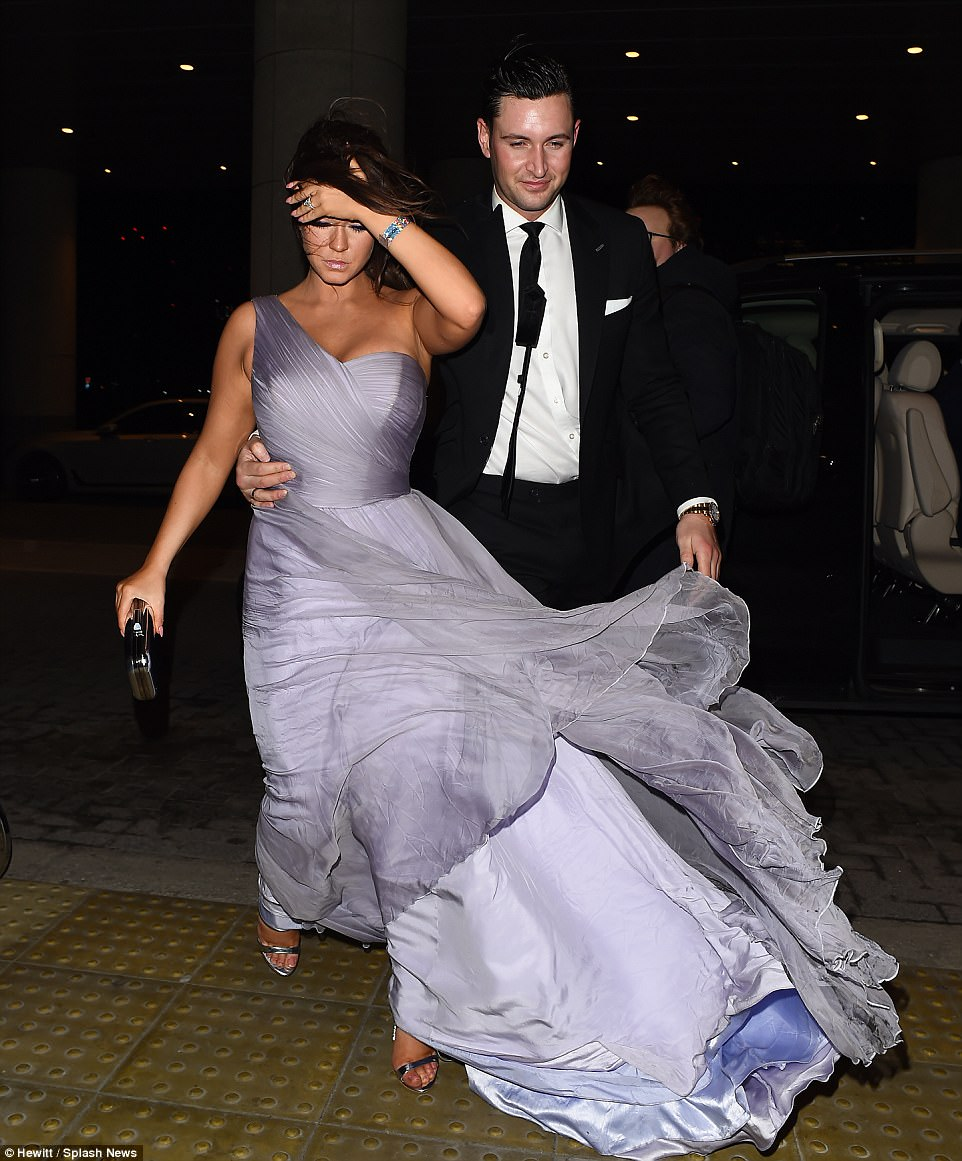 Swept away: Vicky's glamorous dress was blown up but she was more concerned about her hair