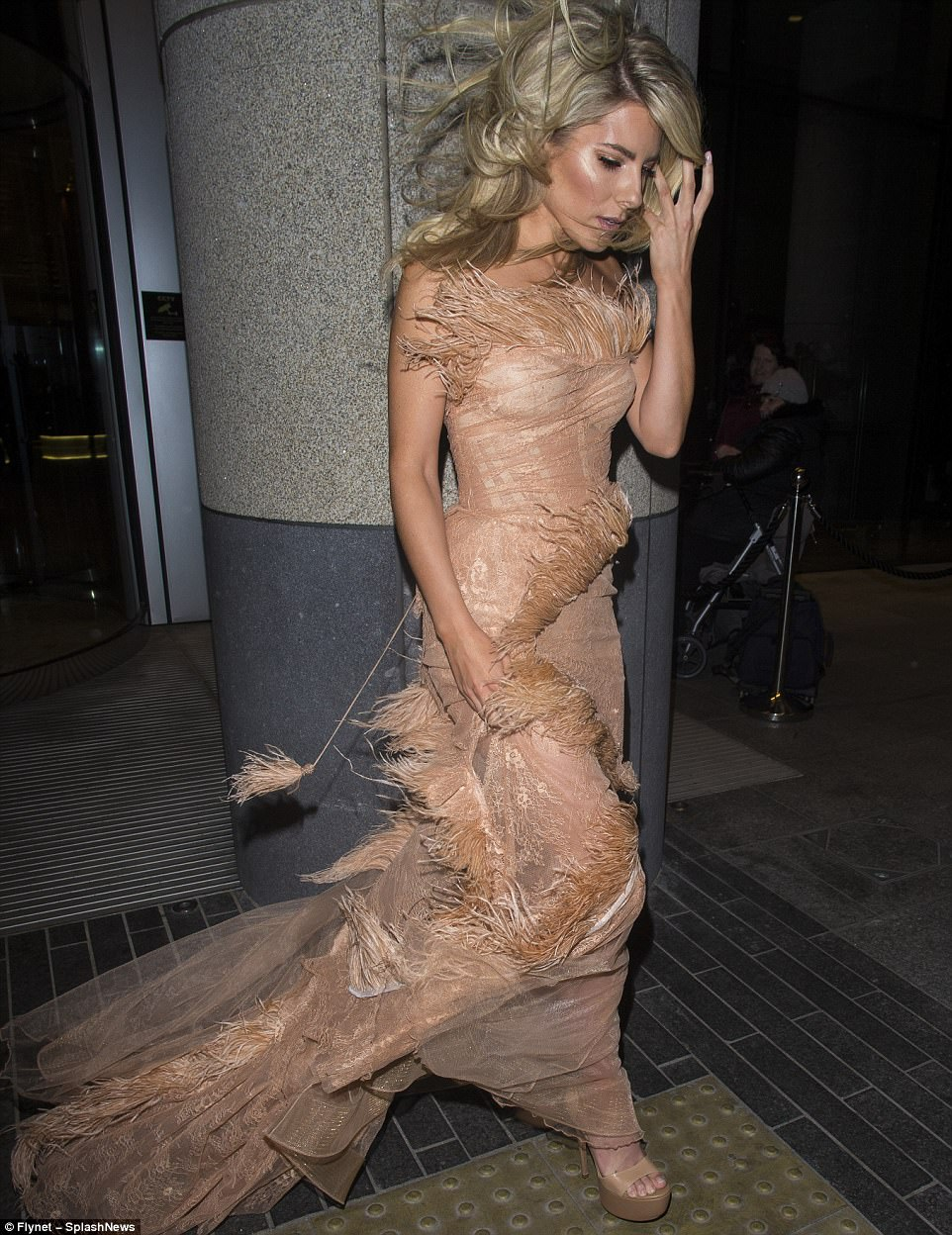 Gong with the wind: Mollie King was struggling with her feathers and her long flowing do