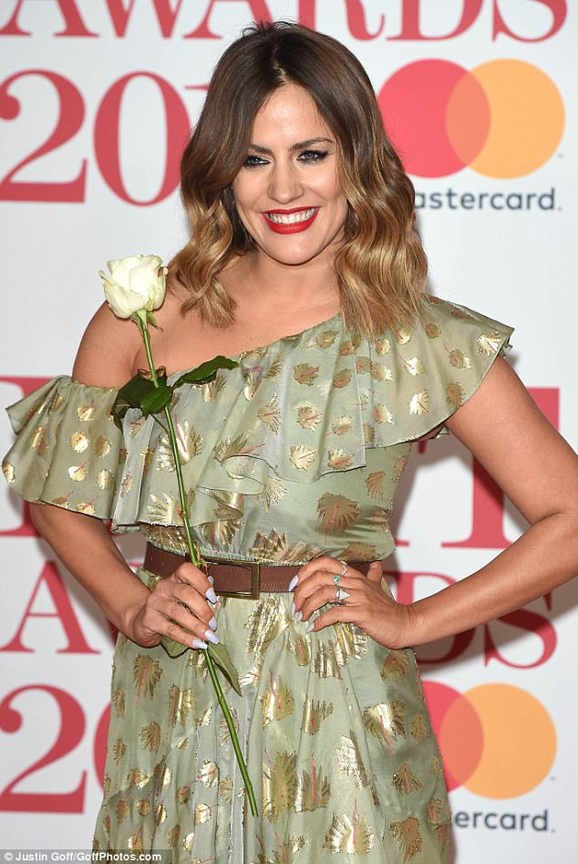 Gorgeous: The Love Island host put on a glamorous display as she slipped her toned figure into the light green dress, which was teamed with a simple tan belt