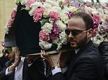Heartbreaking: Murat Gezer carries the coffin of his fiancee Mina Basaran, 28, at her funeral in Istanbul, Turkey, on Thursday
