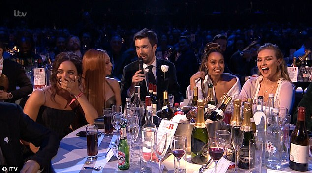 Oh my god! Bandmate Jade (L) and the audience immediately broke into laughter, while Leigh-Anne and Perrie gasped in shock (R)