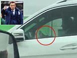 Football coach Phil Neville has issued an apology after being snapped using his phone behind the wheel of his £70,0000 Mercedes