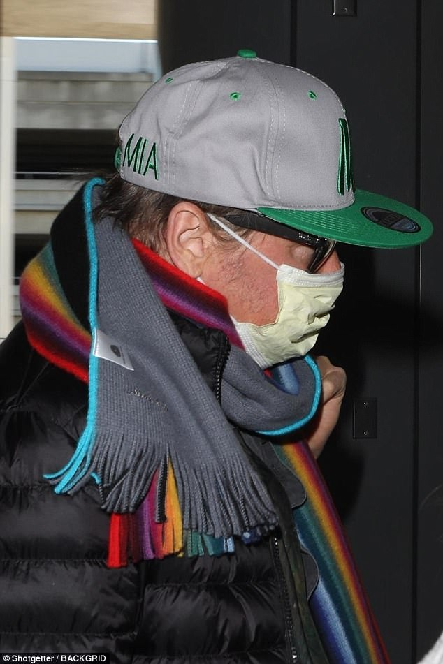 Careful:Val Kilmer looked to be in hiding on Tuesday as he wore a surgical mask when he arrived at LAX airport in Los Angeles