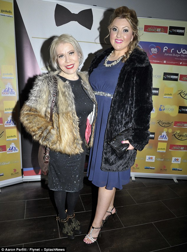 Night out: Seemingly cheerful, the actress posed with a female pal as she ensured her light blonde locks and outfit were glammed-up for the charity event