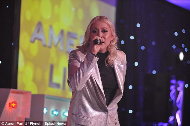 Owning the stage: The musician wore a sparkling suit jacket with PVC trousers
