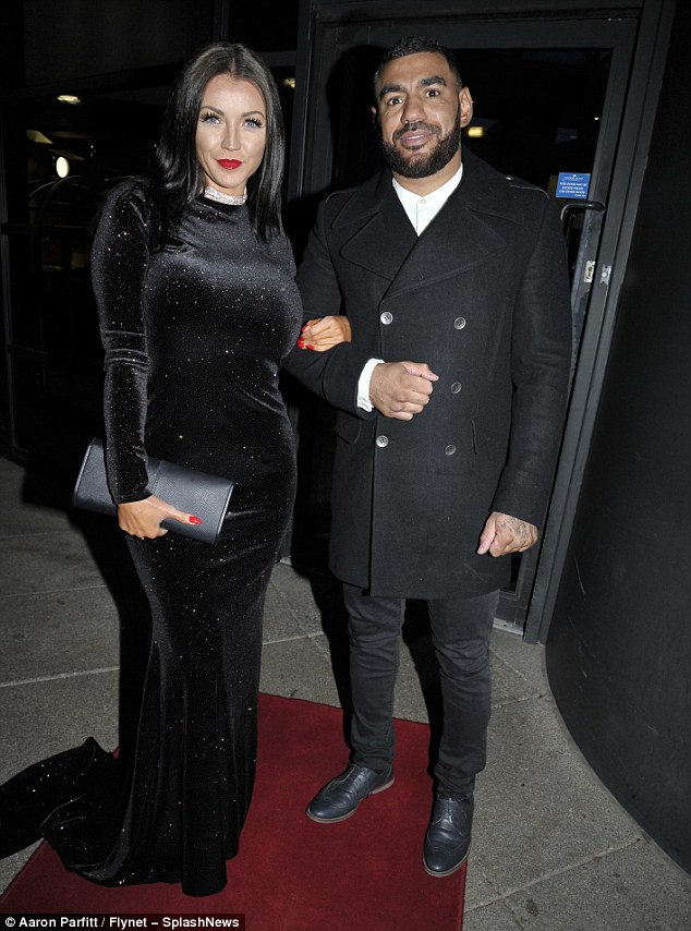 Out to impress: Accompanied by a male companion, Holly wore full lashes and accessorised with glamorous red lips and nails