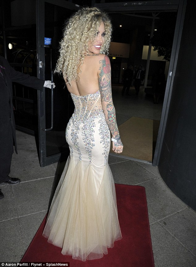 Red carpet ready:Showing off her best poses, Sallie oozed glamour as she sported silver accessorises to match the jewelled corset that clinched her in at the waist and derriere