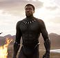 """FILE - This file image released by Disney and Marvel Studios' shows Chadwick Boseman in a scene from """"Black Panther."""" """"Black Panther"""" has become the first film since 2000's """"Avatar"""" to top the weekend box office five straight weekends. According to studio estimates Sunday, March 18, 2018, """"Black Panther"""" grossed $27 million in ticket sales over the weekend, pushing its domestic haul to $605.4 million. (Marvel Studios/Disney via AP, File)"""