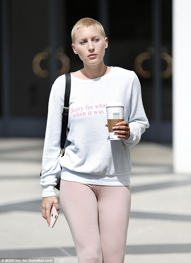 Gilles carried a large coffee cup and wore a sweatshirt saying, 'Sorry for what I said when it was winter' as she met with her lawyer on Wednesday