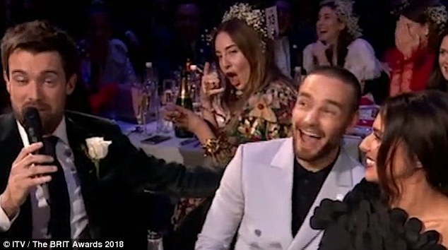 'Call me!': Haim bassist Este stole the show in a hilariously video-bombed during Liam Payne and Cheryl's live TV interview at the BRIT Awards