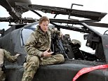 The prince is pictured on an Apachi, the kind of helicopter he co-piloted to save US servicemen and spray the Taliban with bullets