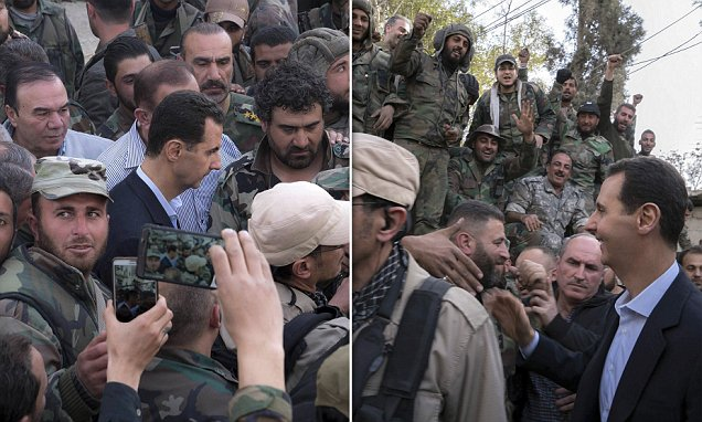 Syrian president Assad greets and poses for selfies with soldiers