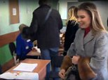 The glamorous 34-year-old arrived alone at a central Moscow polling station and appeared to be wearing a wedding ring