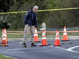FBI investigators inspect the site of the fourth bombing in Austin on Monday morning.Police had warned residents to remain indoors overnight as they looked for possible links to other package bombings elsewhere in the city this month