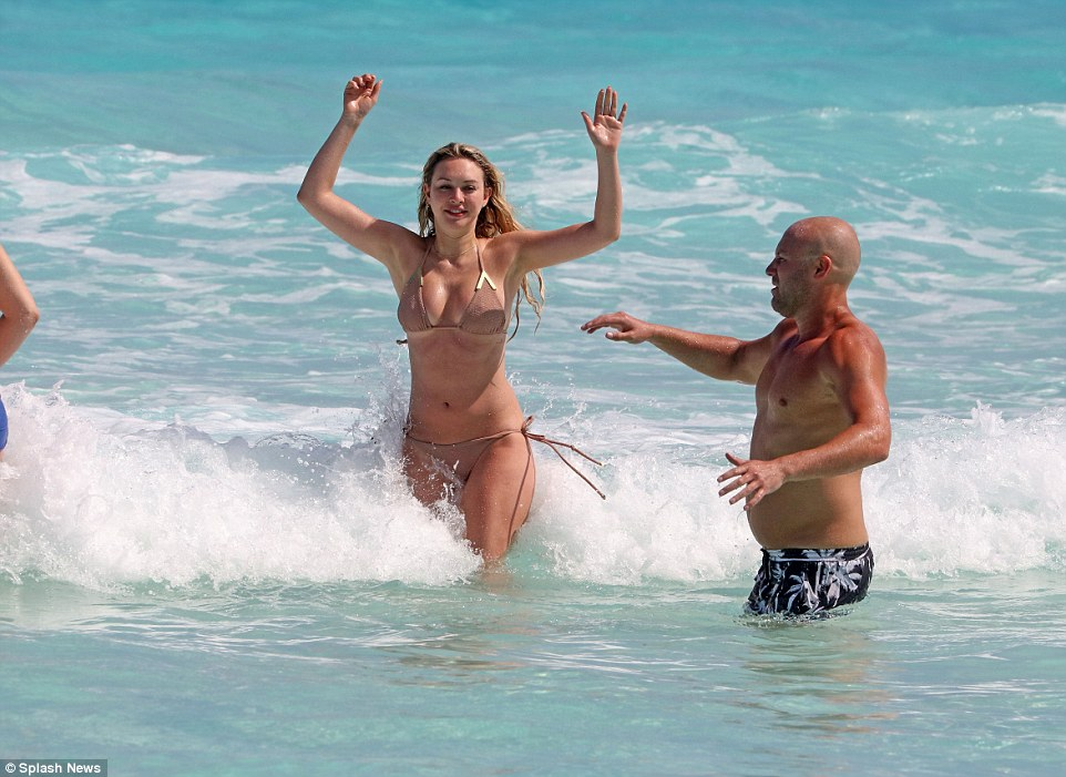 Look at me! The pretty blonde flaunted her figure in a nude halter neck bikini