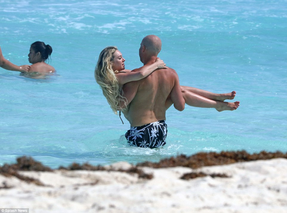 Lift-off! The 25-year old reality television star put on a very public display of affection with a mystery male in Tulum, Mexico