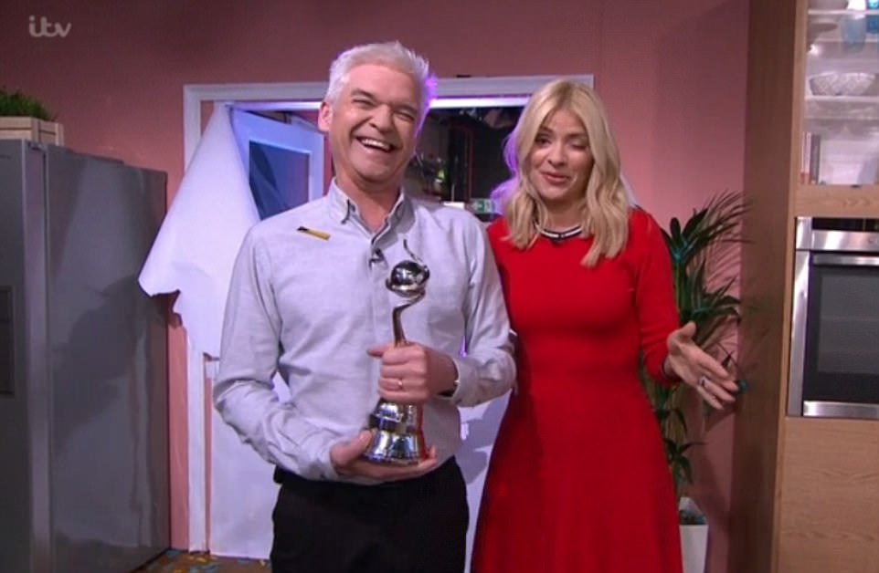 We're sorry...Our presenters haven't turned up': Phillip Schofield nearly vomited live on air before climbing into BED with a very bleary-eyed Holly Willoughby on This Morning on Wednesday following a very boozy night at the NTAs